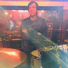 Brian sitting at drum set